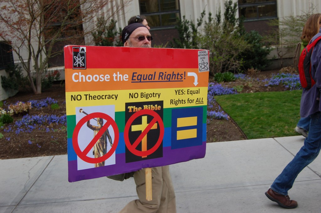 One of two signs carried by the atheists as they marched around Temple Square.