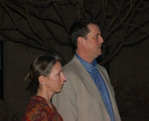 John Dehlin addresses those at the vigil with his wife, Margi, at his side.