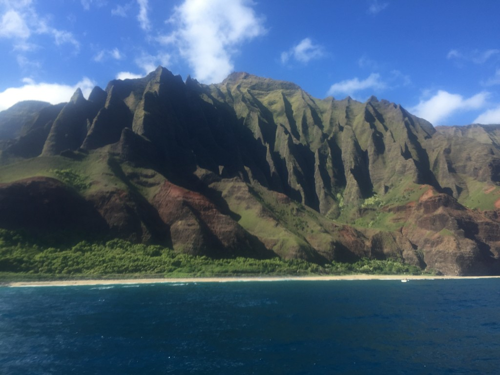 Along the Napali coast, which is only easily accessible by boat or helicopter. The 1,500 to 3,500 foot cliffs are stunning and present a natural barrier to driving around the island.